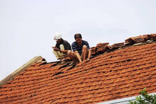 Cận cảnh trường học tan hoang, nhà cửa đổ nát sau bão - Ảnh 18.