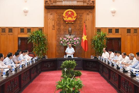 Thủ tướng dẫn việc hộ đê để nhắc nhở Tập đoàn Dầu khí - Ảnh 1.
