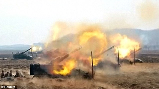 Hình ảnh một cuộc diễn tập bắn pháo của Triều Tiên. Ảnh: Reuters