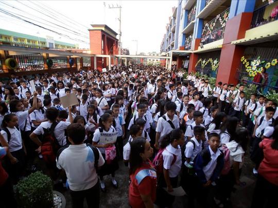Chùm ảnh đẹp về ngày tựu trường ở 12 quốc gia trên thế giới - Ảnh 3.