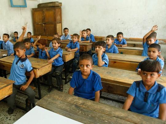 Chùm ảnh đẹp về ngày tựu trường ở 12 quốc gia trên thế giới - Ảnh 5.