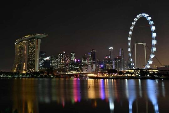Khu vực Marina Bay của Singapore tham gia sự kiện Giờ Trái đất hôm 25-3 Ảnh: THE STRAITS TIMES