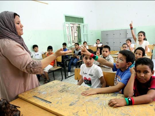 Chùm ảnh đẹp về ngày tựu trường ở 12 quốc gia trên thế giới - Ảnh 8.