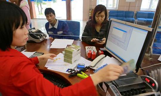 Ứng phó dịch Covid-19, ngân hàng giảm phí tra cứu thông tin tín dụng - Ảnh 1.