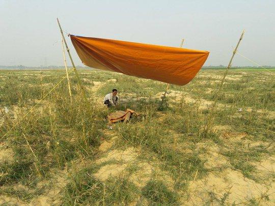 Thi thể ông Thuật được người dân phát hiện tại khu vực bãi bồi xã Điện Quang