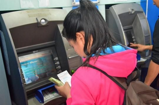 ATM trục trặc, chủ máy bị phạt - Ảnh 1.