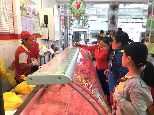 Giá thịt heo bình ổn tăng tới 7.000 đồng/kg - ảnh 1