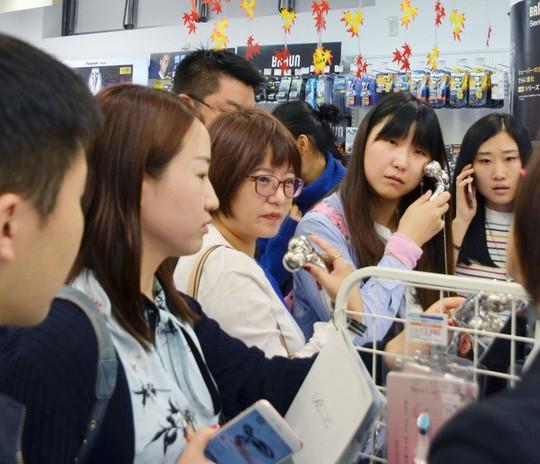 Sắp tới, vào Nhật có thể xin thị thực qua mạng - Ảnh 1.
