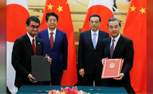 Ông Donald Trump đẩy Trung - Nhật lại gần nhau - Ảnh 1.