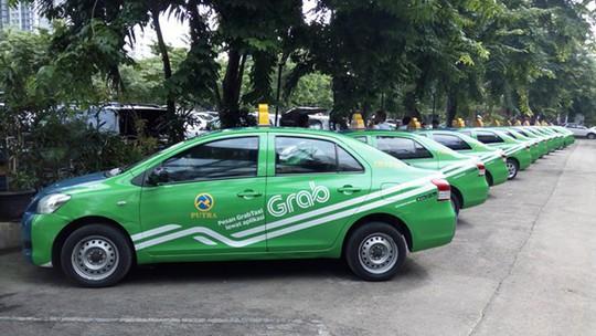 Nhiều nước quản Uber, Grab như taxi truyền thống - Ảnh 1.