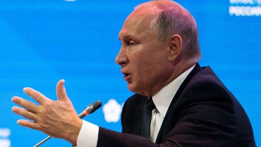 Tổng thống Putin gọi cựu điệp viên bị đầu độc là kẻ phản quốc - Ảnh 1.