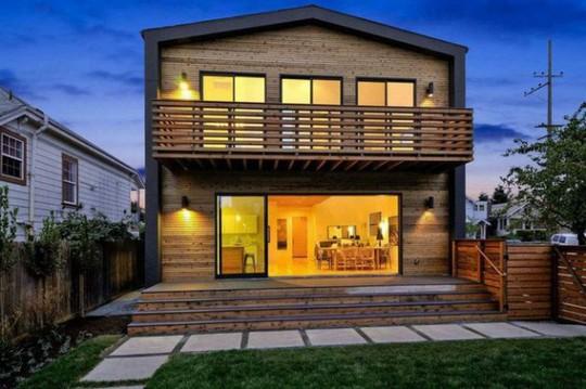 Ngôi nhà gỗ đơn giản bên ngoài, hiện đại bên trong - Ảnh 4.