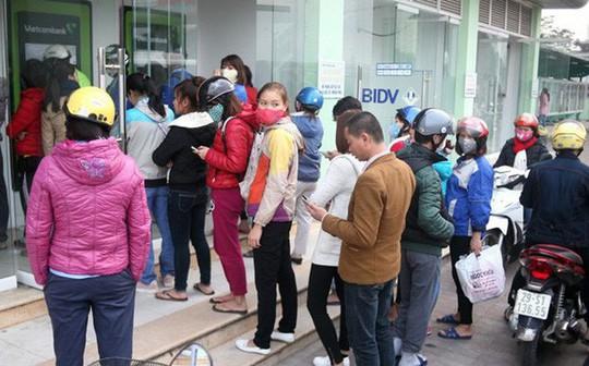 Ngân hàng Nhà nước lại nhắc nhở chuyện ATM quá tải dịp Tết - Ảnh 1.