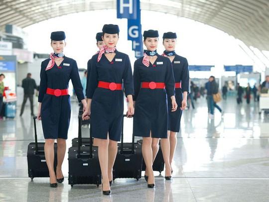 Những hãng hàng không có đồng phục thanh lịch nhất thế giới - ảnh 6
