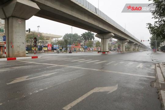 Không ồn ào vội vã, Sài Gòn - Hà Nội được trả lại vẻ yên bình trong ngày mùng 1 Tết - Ảnh 12.