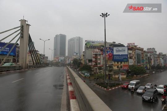 Không ồn ào vội vã, Sài Gòn - Hà Nội được trả lại vẻ yên bình trong ngày mùng 1 Tết - Ảnh 13.