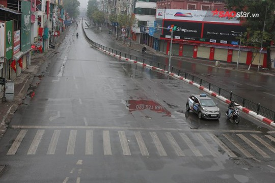 Không ồn ào vội vã, Sài Gòn - Hà Nội được trả lại vẻ yên bình trong ngày mùng 1 Tết - Ảnh 14.