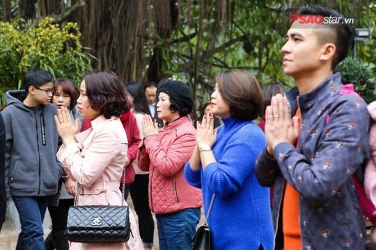 Không ồn ào vội vã, Sài Gòn - Hà Nội được trả lại vẻ yên bình trong ngày mùng 1 Tết - Ảnh 23.