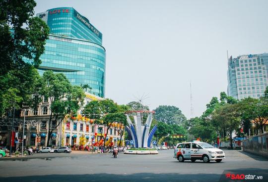 Không ồn ào vội vã, Sài Gòn - Hà Nội được trả lại vẻ yên bình trong ngày mùng 1 Tết - Ảnh 4.