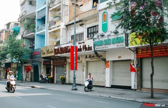 Không ồn ào vội vã, Sài Gòn - Hà Nội được trả lại vẻ yên bình trong ngày mùng 1 Tết - Ảnh 6.