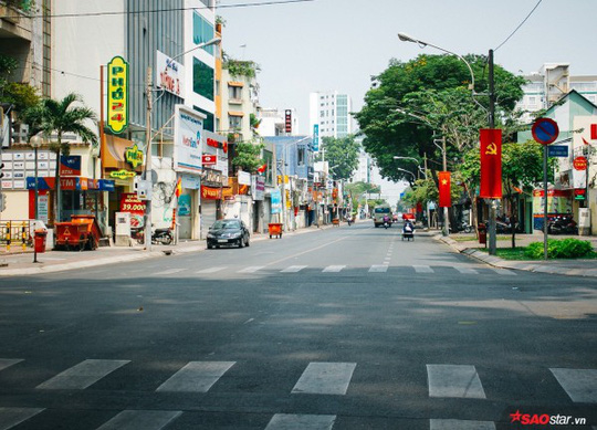 Không ồn ào vội vã, Sài Gòn - Hà Nội được trả lại vẻ yên bình trong ngày mùng 1 Tết - Ảnh 7.