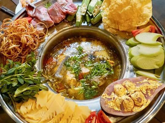 Món ăn dát vàng 24k gây tò mò trong ngày Thần Tài - Ảnh 1.