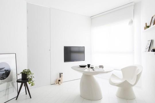 Căn hộ 42m² rộng thênh thang nhờ màu trắng tinh khôi - Ảnh 2.