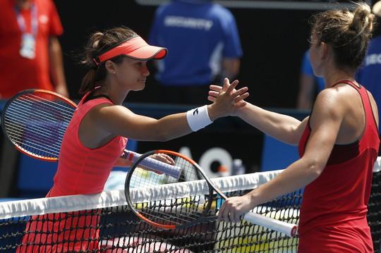 Sharapova bị loại, Halep thoát hiểm sau gần 4 giờ - Ảnh 1.
