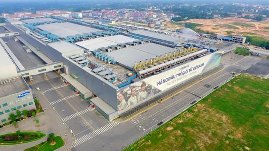 Doanh nghiệp Việt cố chen vào chuỗi cung ứng - Ảnh 1.