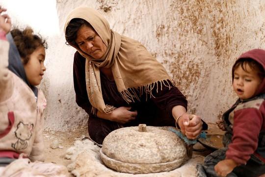 Những gia đình cuối cùng sống dưới lòng đất ở Tunisia - Ảnh 15.