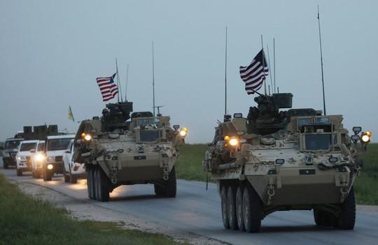 Mỹ đưa 5.000 xe tải chở vũ khí đến Syria - Ảnh 1.