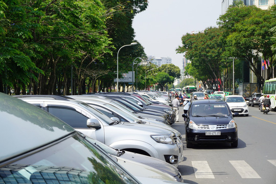 Từ 1-8, TP HCM thu phí ô tô bằng công nghệ với mức giá mới - Ảnh 1.