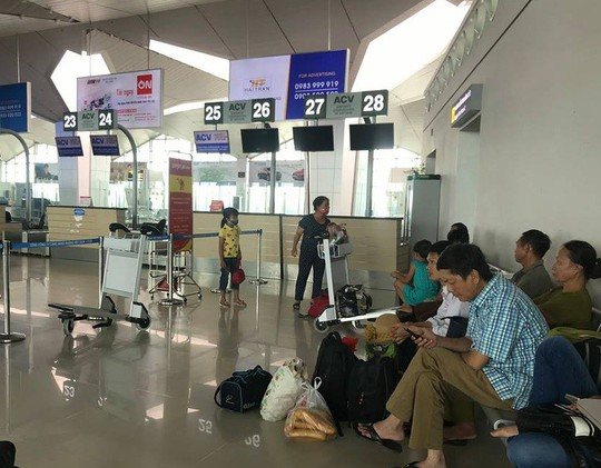 Làm rõ nghi vấn khách Trung Quốc để quên phong bì có 10.000 USD tại sân bay Vinh - Ảnh 1.