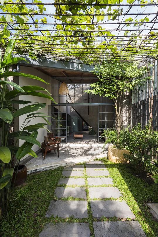 Ngôi nhà cấp 4 đẹp đơn sơ giữa lòng Sài Gòn - Ảnh 1.