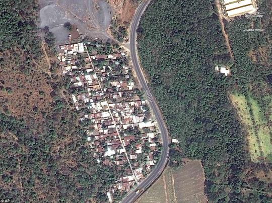Khốc liệt hình ảnh trước và sau thảm họa núi lửa ở Guatemala - Ảnh 1.