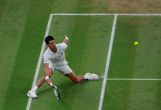 Loại Isner, Kevin Anderson vào chung kết Wimbledon - Ảnh 7.