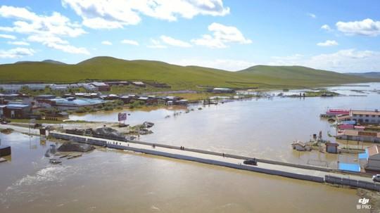 Lũ lụt Trung Quốc: Hàng chục người chết, thiệt hại 3,87 tỉ USD - Ảnh 7.