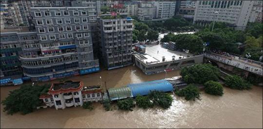 Lũ lụt Trung Quốc: Hàng chục người chết, thiệt hại 3,87 tỉ USD - Ảnh 4.