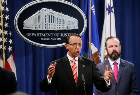 Trước thượng đỉnh Trump-Putin, Mỹ truy tố 12 sĩ quan tình báo Nga - Ảnh 1.