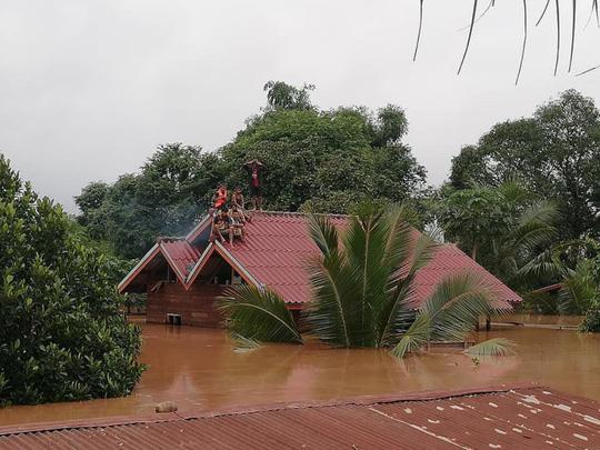 Đại thảm họa vỡ đập thủy điện ở Lào sát mé Việt Nam, cuốn hàng trăm người - Ảnh 5.