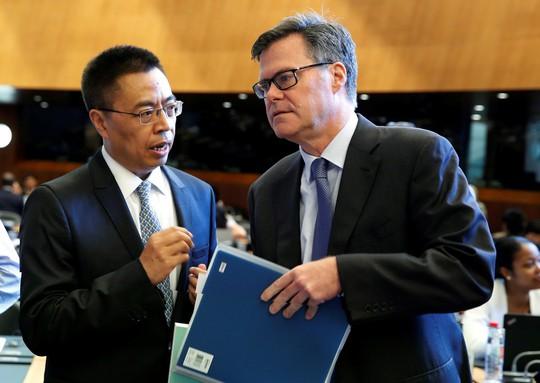 """Mỹ-Trung tranh cãi """"sặc mùi thuốc súng"""" tại WTO - Ảnh 1."""