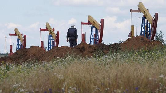 Giá dầu tăng, Nga hưởng lợi 4.000 tỉ rúp - Ảnh 1.