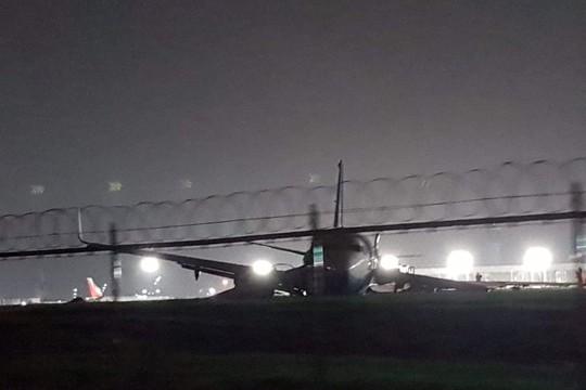 Máy bay Trung Quốc trượt khỏi đường băng, một động cơ rời ra - Ảnh 2.