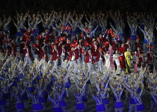 Quốc kỳ Việt Nam tung bay tại lễ khai mạc ASIAD 2018 - Ảnh 4.