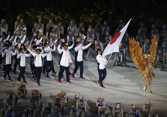 Quốc kỳ Việt Nam tung bay tại lễ khai mạc ASIAD 2018 - Ảnh 7.