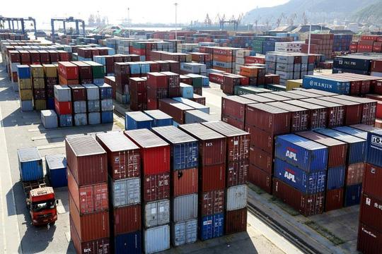 Đấu thương mại có Mỹ, Trung Quốc có thể mất 700.000 việc làm - Ảnh 1.