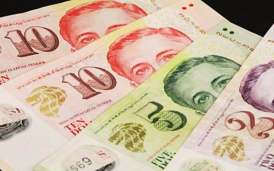 Phía sau việc Chính phủ Singapore chia tiền cho người dân - Ảnh 1.