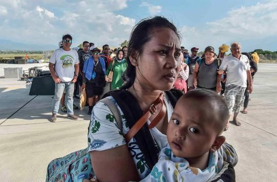 Thảm họa động đất - sóng thần ở Indonesia: Ít nhất 420 người thiệt mạng - Ảnh 1.
