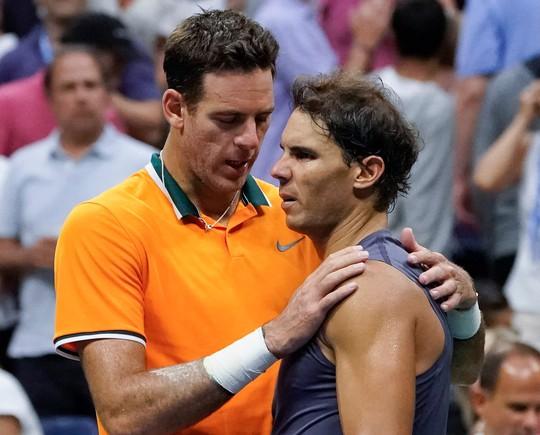 Nadal bỏ cuộc vì chấn thương, Del Potro vào chung kết có Djokovic - Ảnh 7.