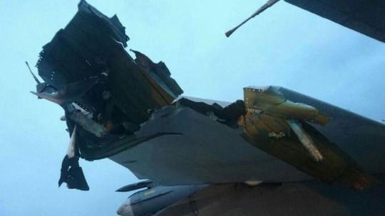 Rộ ảnh máy bay Nga bị hư hại tại Syria - Ảnh 1.